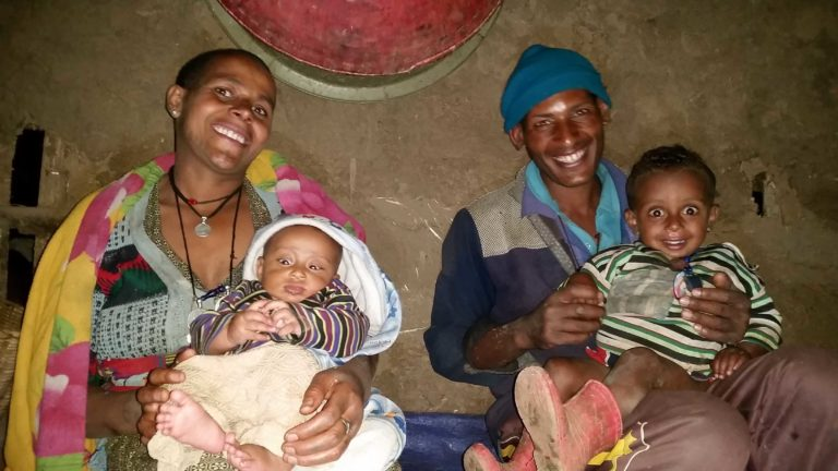 """Tesfaye with his wife Wuba and their kids at home. The smart farmer is known as a """"wise man"""" in the community regardless his young age."""